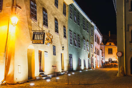 SIGHISOARA, ROMANIA - JULY 07, 2015: Night view of historic town Sighisoara. City in which was born Vlad Tepes, Dracula Editorial