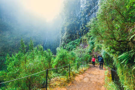 Madeira, Portugal 04 JULY, 2016: Unidentified people walking to Levada Risco, Madeira Island, Portugal Editorial