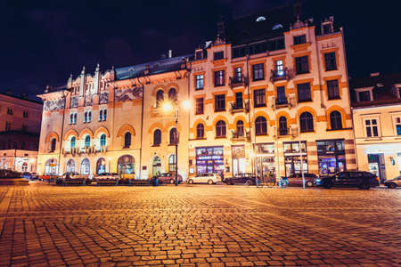 KRAKOW, POLAND - December 15, 2017: Szczepanski Square and The Old Theater in the night in Krakow, Poland