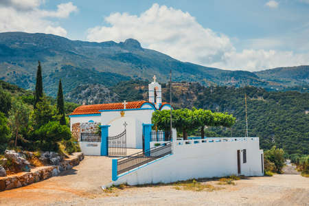 White chapel and mountains in the backgroud, Crete Island, Greece