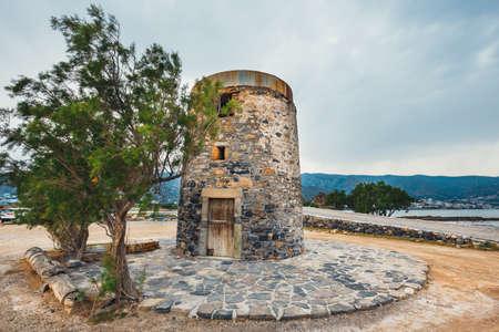 Ancient windmill on Kalydon Peninsula near Agios Nikolaos, Crete, Greece