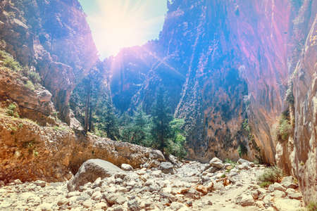 Sun is shining through the edge of canyon in Samaria Gorge in Central Crete Stock Photo