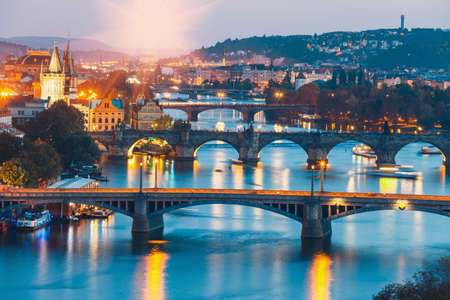 bridges with historic Charles Bridge and Vltava river at night in Prague, Czech Republic Stock Photo
