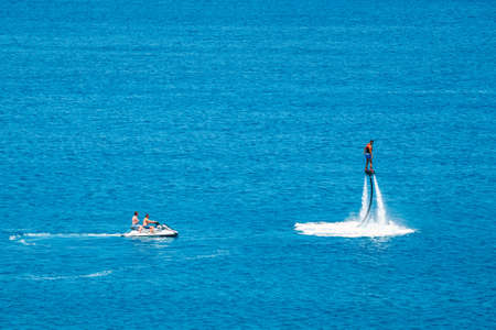 Crete, Greece - June 11, 2017: Flyboard show on the Vai Beach on the Island of Crete, Greece. Flyboard is the new spectacular extreme sport