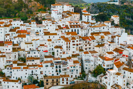 White Andalusian village - pueblo blanco - in the mountain range in Casares during sunset