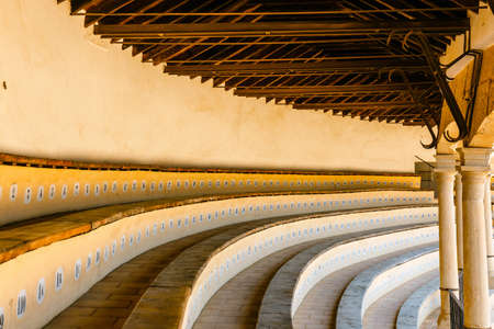 Close-up on the grandstand for spectators in the bullring, Ronda, Spain