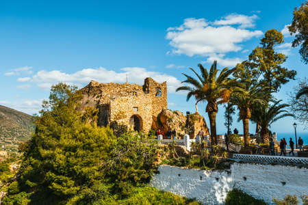 Mijas, Spain, April 08, 2018: Tourists visit Virgen de la Pena chapel ( Virgin of the Rock) in Mijas. Andalusia, Spain 스톡 콘텐츠 - 104639489