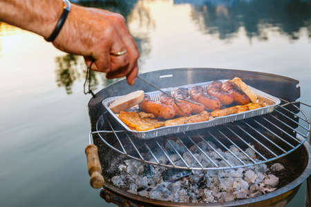 Grilled sausage on the flaming grill, close up Stock Photo