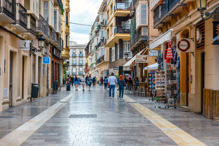 Malaga, Spain, April 03, 2018: Narrow street in the historical center of Malaga where tourists are seeking for shops Editoriali