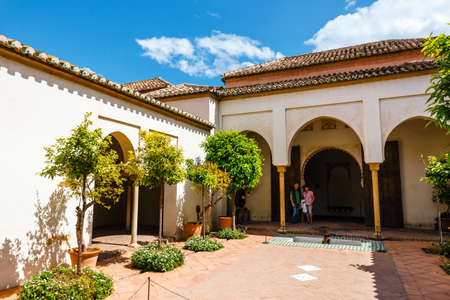 Malaga, Spain, April 03, 2018: courtyard of alcazaba castle in Malaga, Costa del Sol, Spain