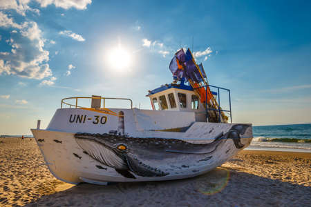 Uniescie, Poland, May 28, 2018: fishing boat painted in fanciful shapes like an octopus and a whale 에디토리얼