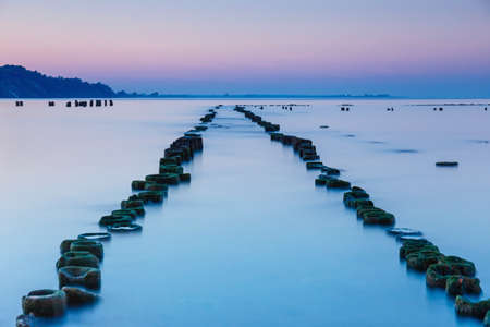 Blue hour at the sea. Beautiful and tranquil sunset over the sea Imagens