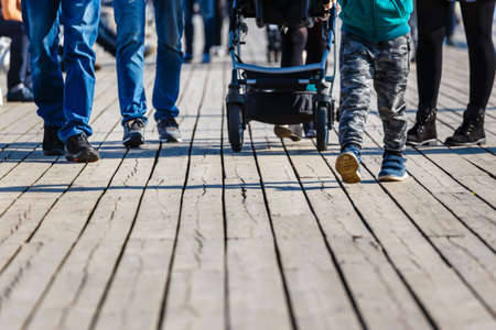 cropped image of family walking with baby carriage