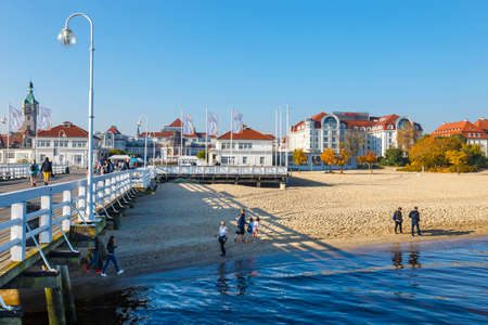 Sopot, Poland, October 13, 2018: View of  the longest wooden pier in Europe. The Sopot Pier was built in 1827 Zdjęcie Seryjne - 128136345