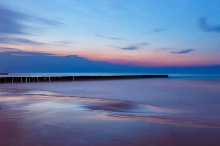 Breakwater at beautiful sunset, Baltic Sea, Poland