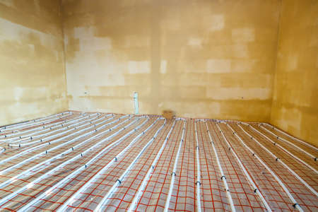 Close up on water floor heating system interior
