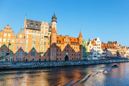 Sunny day at embankment of Motlawa river in historical part of Gdansk, Poland