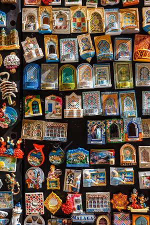 Malaga, Spain- April 03, 2018: Ceramic souvenirs for sale in Malaga, Spain. Colorful Fridge souvenir magnets