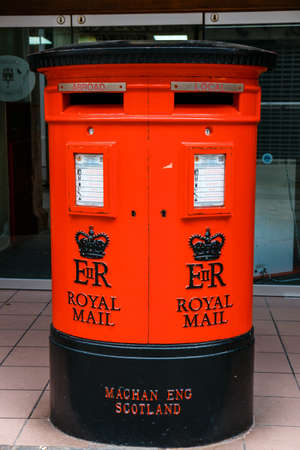 Gibraltar, United Kingdom, April 07, 2018: The post box in Old town of Gibraltar, United Kingdom. Gibraltar is a British Overseas Territory located on the southern end of the Spain