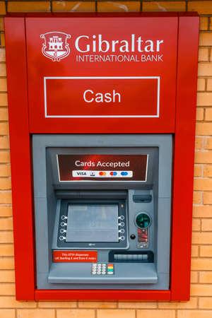 Gibraltar, United Kingdom, April 07, 2018: Gibraltar International Bank atm on Main Street. Gibraltar is a British Overseas Territory Publikacyjne