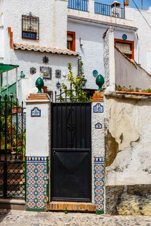 Granada, Spain, April 06, 2018: Traditional arabic architecture of Andalusia, Albaicin Moorish medieval quarter, Granada, Spain Zdjęcie Seryjne - 128080723