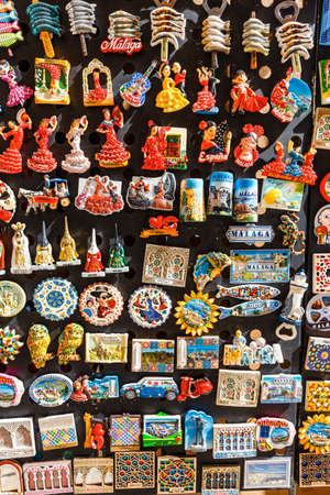 Malaga, Spain- April 03, 2018: Ceramic souvenirs for sale in Malaga, Spain. Colorful Fridge souvenir magnets Zdjęcie Seryjne - 128080727