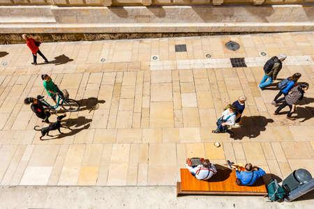 Malaga, Spain, April 03, 2018: top view of people walking around the alcazaba fortress, Malaga, Spain Publikacyjne