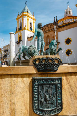 Ronda, Spain, April 05, 2018: Statue of Hercules with two lions, Plaza del Socorro, Ronda, Spain Zdjęcie Seryjne - 128137645