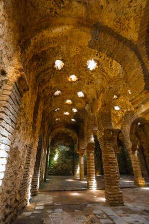 Ronda, Spain, April 05, 2018: The ruins of the Arab baths in town of Ronda, Andalusia, Spain Zdjęcie Seryjne - 128137637