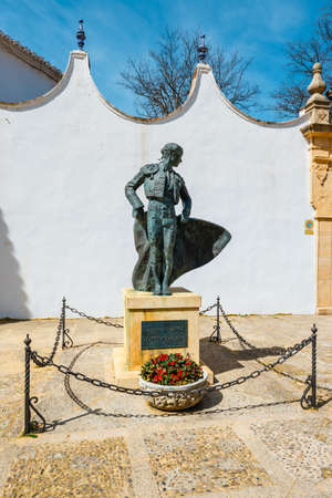 Ronda, Spain, April 05, 2018: A statue at the entrance to the Plaza de Toros in Ronda, Spain Zdjęcie Seryjne - 128137671