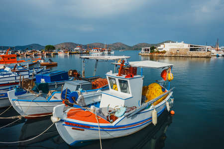 Crete, Elounda, June 07, 2017: Ships and fishing boats in the harbor of Elounda, Crete, Greece Zdjęcie Seryjne - 128138030