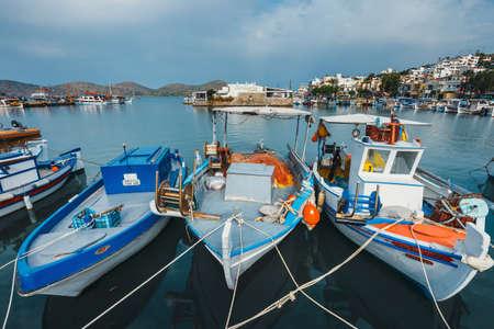 Crete, Elounda, June 07, 2017: Ships and fishing boats in the harbor of Elounda, Crete, Greece Zdjęcie Seryjne - 128138035
