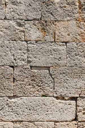 Old beige stone wall background texture, close up Zdjęcie Seryjne - 128704220