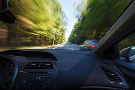 windshield: Driving in good weather conditions, overtaking Stock Photo