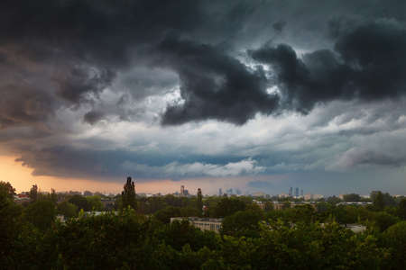 stormy clouds: Stormy clouds over city