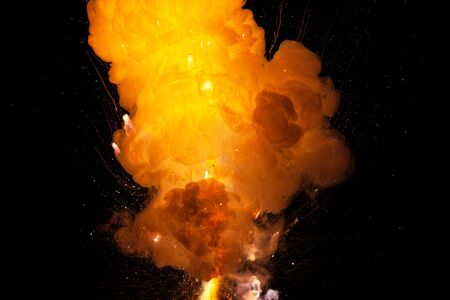 Realistic fiery explosion, orange color with sparks isolated on black background Stock Photo