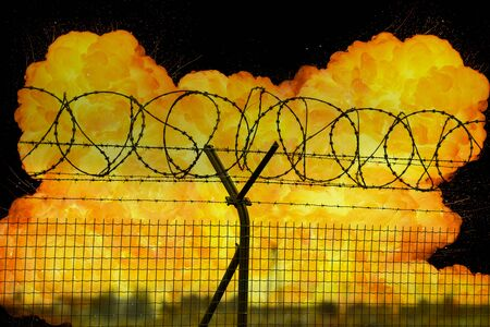 Realistic orange fire explosion behind restricted area barbed wire fence
