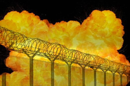 chainlink fence: Realistic orange fire explosion behind restricted area barbed wire fence