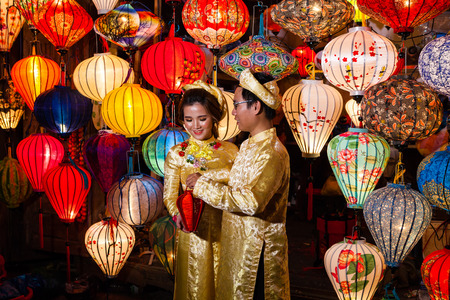 Hoi An, Vietnam - march 11 2017: vietnamese brides in traditional costume against colorful lanterns, Full Moon festival night