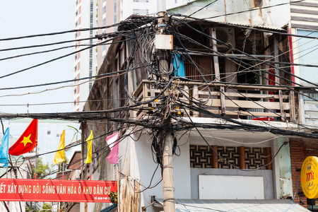 Da Nang, Vietnam - march 11 2017: typical street with messy cable infrastructure in Vietnam. The result of such solution is lack of electricity or Internet during the rain Editorial