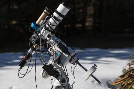 Professional astrophotography telescope equipped with guider scope and astro camera ready for night session
