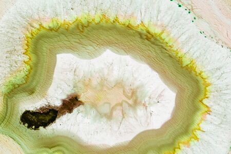 Abstract background - yellow and green agate mineral cross section Abstract background - green agate mineral cross section