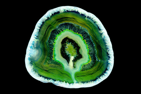Abstract background - dark green agate mineral cross section isolated on black background