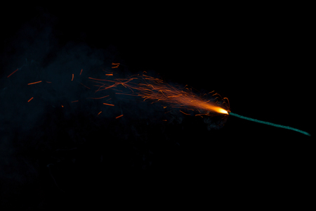 Burning fuse with sparks isolated on black background Stock Photo