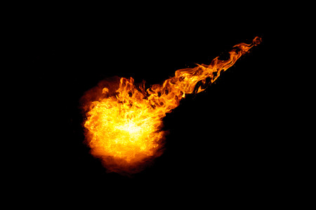 Meteorite fireball with fiery braid isolated on black background