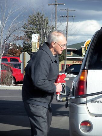 SPOKANEWASHINGTON STATE USA _Consumer pumping gasoline from costco gasoline  station 7 Mach 2011