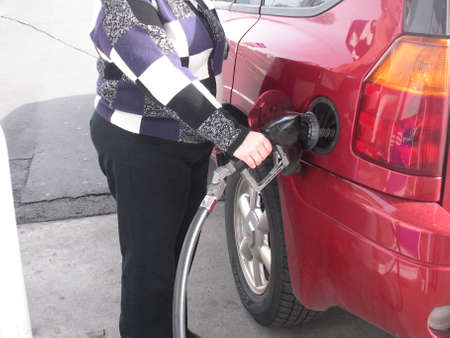 LEWISTONIDAHOUSA _ Rising gasoline price in world  among United States too, female pumping gas at Libberty gas station 9 March 2011        Editorial