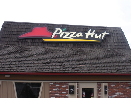 LEWISTONIDAHOUSA _  American chian food restaurant Pizza Hut ,Super sprieme Pizza and pepsi drinks with chocolate dessert Pizza dip in chocolate sourse  12 March 2011