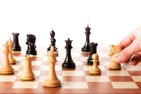 playing  chess: Playing chess game - white knight attacks black queen