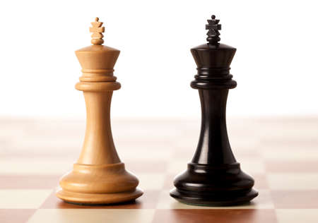 chess pieces: Impossible situation - two chess kings standing next to each other Stock Photo